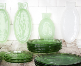 green glass plates and servers