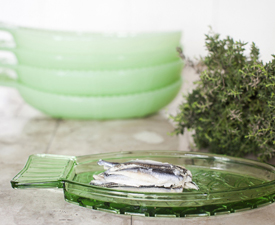 green glass bowls and plates